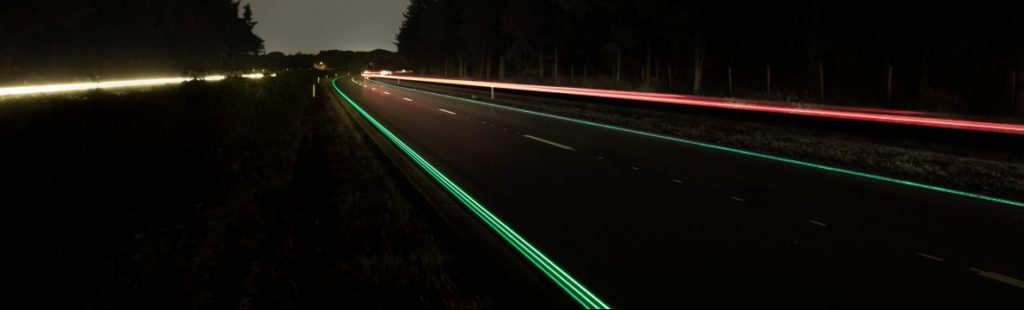 Image of a night road with reflective signs