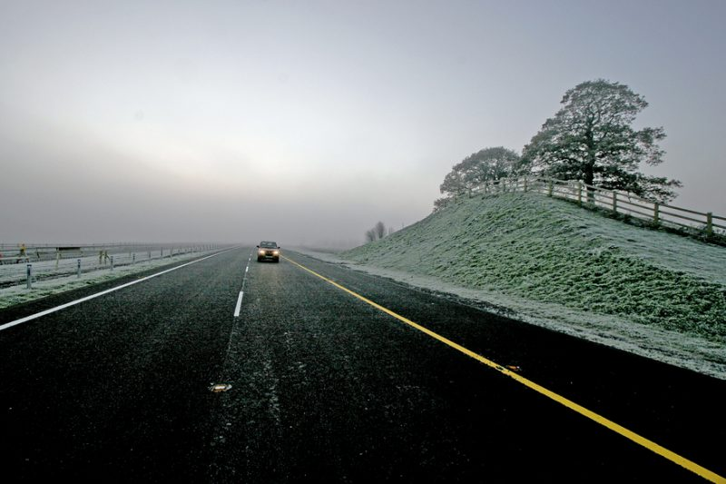 A road flanked by ice and snow