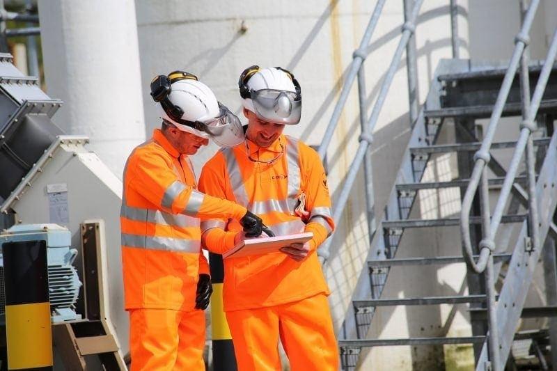 Workers on-site in hi-vis vests