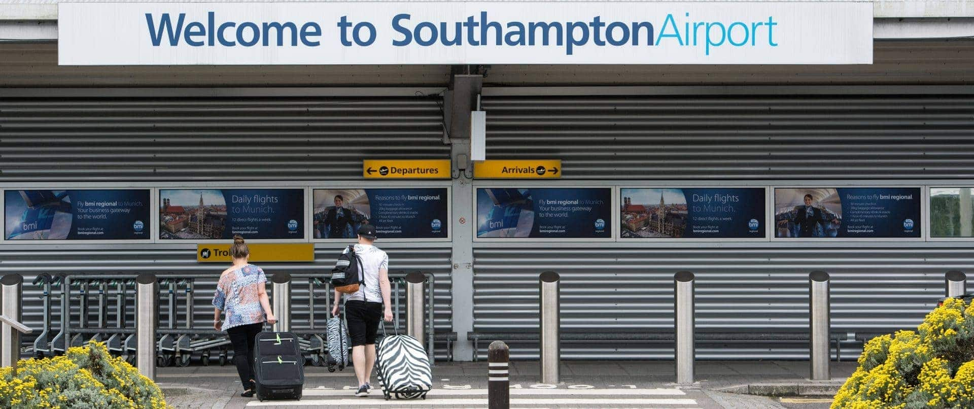 Image of two people arriving at Southampton airport