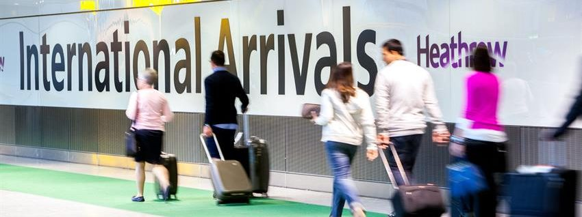 Photo of passengers with suitcases at Heathrow Airport