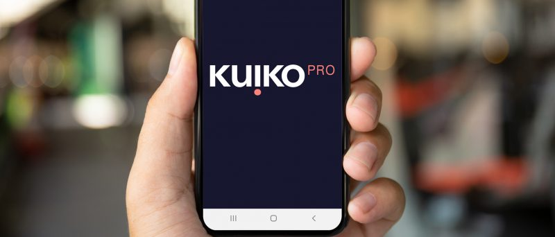 Image of a hand holding a mobile phone with Kuiko app