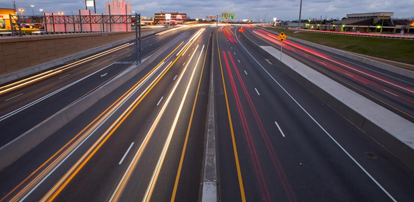 Image of a highway with car lights